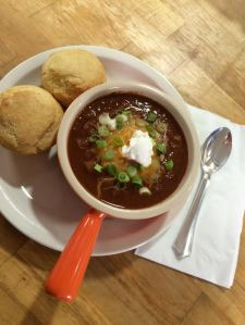 Hearty Chili with cheese, green onions and sour cream. (toppings are always optional!)