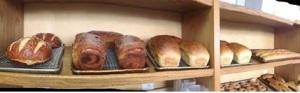 From left: Pretzel Boule, Cinnamon Raisin Bread, Country Wheat, French White, Baguette